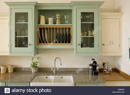 Kitchen Green Walls Pale Green Wall Cupboard Above Double Sink In Country Kitchen