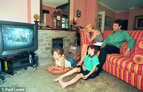 families so busy the only time they spend together is tv