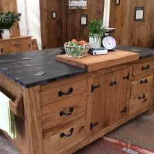 kitchen island unit with chopping block and black cosmic leather