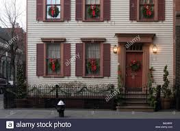 shuttered windows with wreaths adorn the of
