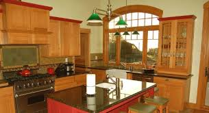 modern l shaped kitchen with granite island top and seating