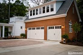 two car garage with white door and brick wall of exterior exterior design two car garage with white door and brick wall of exterior decoration you must