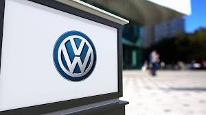 volkswagen wolfsburg emblem street signage board with volkswagen logo blurred office center