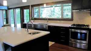 Extra Kitchen Counter Space by Dark Wood Cabinets And Floors Deluxe Home Design