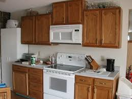 How To Paint Oak Kitchen Cabinets White by Want To Paint Oak Cabinets White Pictures Included Please Help Me