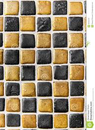 black gold ceramic tile background pattern texture stock photo