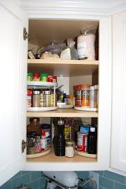 how to organize corner kitchen cabinets organizing spices use turn tables in that awkward corner