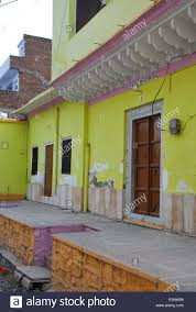 india rajasthan modern village house painted lime green orange