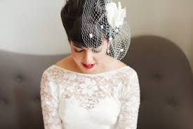 bride in a vintage 1950s short lace tea length dress with birdcage