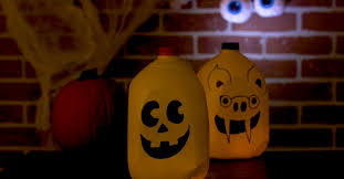 re purpose old milk jugs into these adorable halloween luminaries