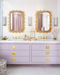 bathroom vanity with purple drawers and golden knobs feature