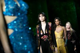 amazonian color dramatic silhouettes hit the paris runways