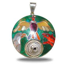 circular pendant with the trilogy on green turquoise with a