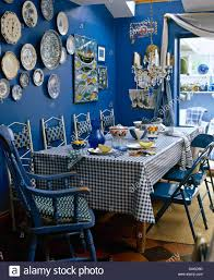 Blue Dining Room Collection Of Pottery Plates On Wall Of Deep Blue Dining Room With