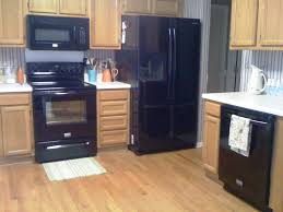 oak kitchen cabinets with black appliances kitchen kitchens with