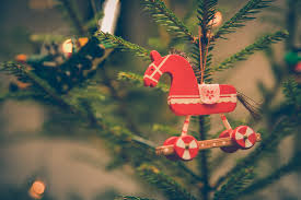 brown and red horse decor hanged on christmas tree free stock photo