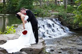 sharon woods cincinnati wedding waterfall kiss on the neck