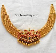 simple gold choker with peacock kundan pendant jewellery designs