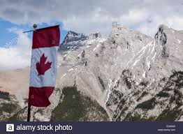 canadian flag in rocky mountains banff national park alberta