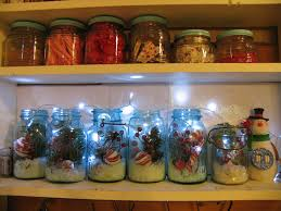 mason jars filled with christmas picks snow and lights for