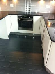 black granite worktop grey and black tiles white gloss units