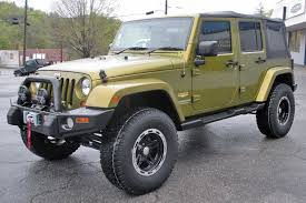 Rescue Green Jeep Wrangler Unlimited Sahara