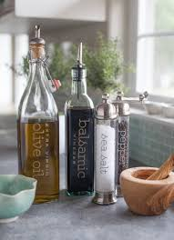 stylish kitchen labels pepper grinder vinegar and olive oils