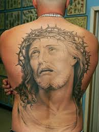 jesusand religous tattoos sorrowful jesus on back