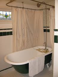 dramatic bathroom with rectangular brass bathtub curtain rod and