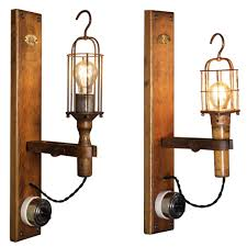 pair of antique industrial modern cage drop light wall sconce