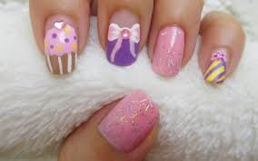 cupcake and bow design birthday nail art