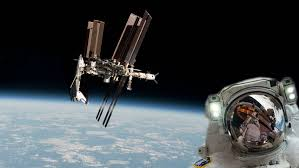space shuttle astronaut space station and shuttle with astronaut by earth stock footage