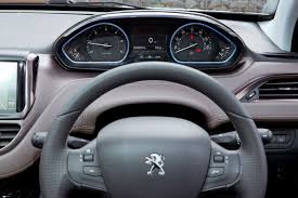 pezo car peugeot interiors tiny steering wheels for all by car magazine