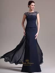 navy blue chiffon cap sleeve prom dress with beaded illusion neck