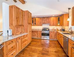 Cherry Cabinets In Kitchen The Kitchen Features Natural Cherry Cabinets Granite Countertops