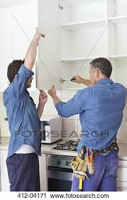 Installing Cabinets In Kitchen Stock Photography Of Workers Installing Cabinets In Kitchen 412