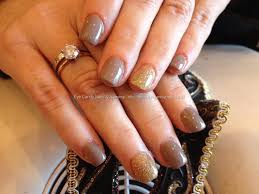 acrylic nails with wild mink gel polish and gold glitter ring