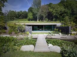 a swimming pool inside a sunken pavilion ignant com