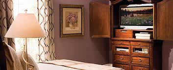 Kathy Ireland Armoire Tucking In A Tv Armoire Amour Raymour And Flanigan Furniture