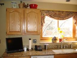 interior vintage kitchen window treatment over the sink with