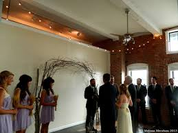 wedding arches made of branches kristen and ed s to earth wedding day rsvp the riverroom