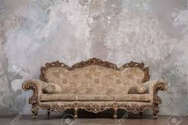 antique sofa against old stucco background stock photo picture