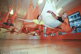 antigravity yoga hanging in silk cocoons u2013 supernoetics