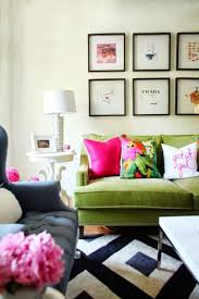 living room with wall gallery decor and green sofa decorating