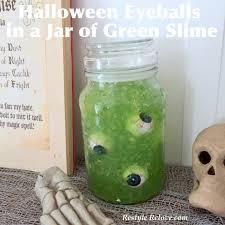 halloween eyeballs in a jar of green slime