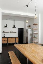 a simple but stylish kitchenette at the offices of magazine