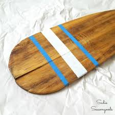 vintage canoe paddle oar repurposed into diy coat hook rack