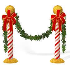 christmas mistletoe free stock photo of candycane poles with mistletoe christmas