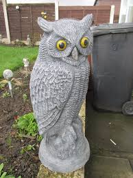 pair of concrete owl garden ornaments in morley west