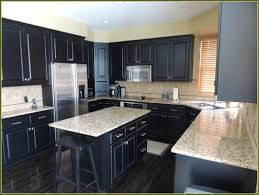 stone countertops dark kitchen cabinets with floors lighting